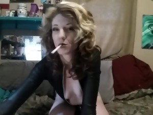 Sexy Smoking Goddess In Black Leather Bodysuit With Zippers Fetish