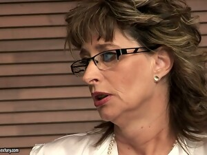 Sexy Mature Teacher Giving A Lesson On Sexual Education